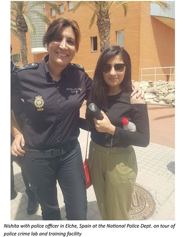 Nishita with police officer in Spain at National Police Department