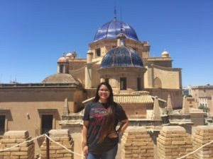 photo of student standing in front of historic building in spain