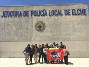 group photo of students in spain in front of spanish police department