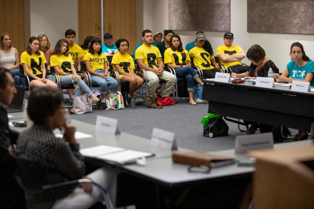 Activists with MOVE Texas at July 31 meeting of the paid sick leave commission